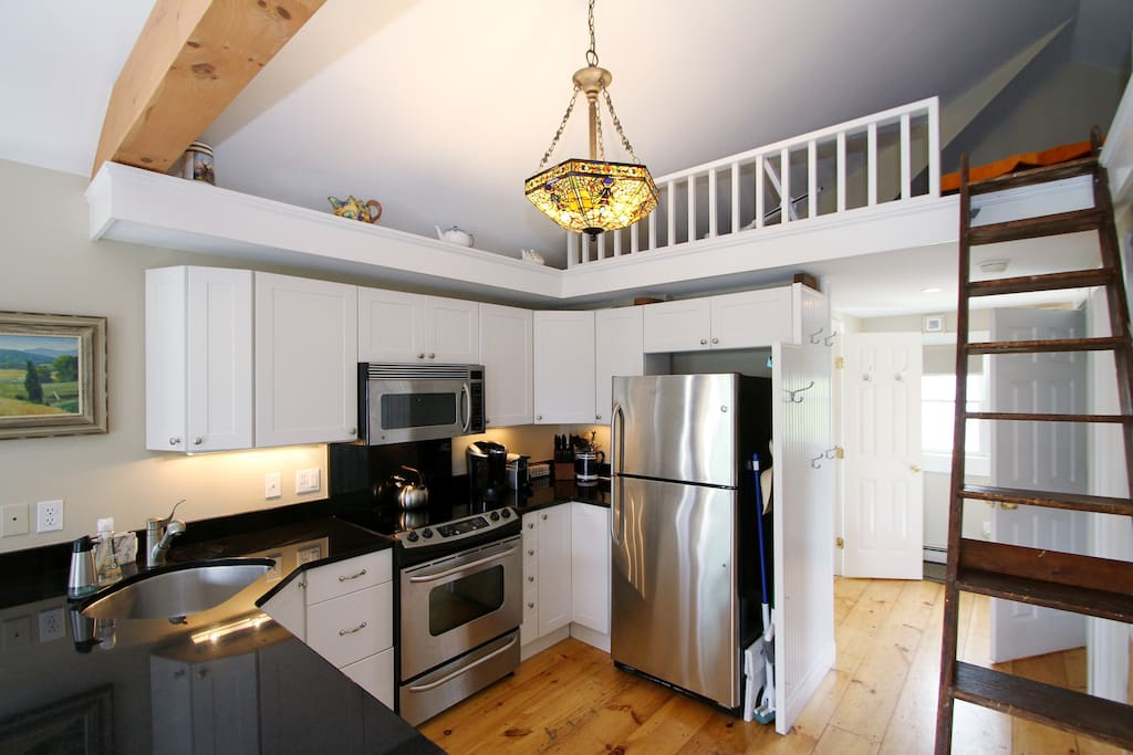 The kitchen has a full suite of stainless steel appliances.