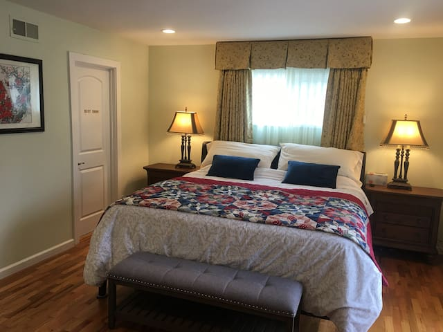 master room with king size mattress & private shower-bathroom