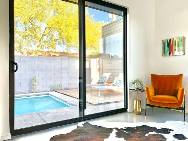 Our master bedroom has ceiling to floor sliding doors straight out to the pool and outdoor dining area.