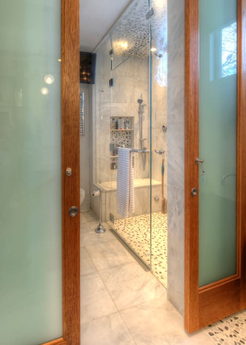 Modern remodeled shower Bathroom: double sized, his and her shower heads, separate water controls, steam shower with lounging bench, heated floors. Lounge and steam after a day of skiing or hiking! Extra large water heater for longer showers.