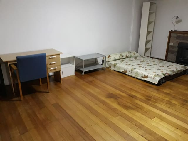 A pretty big room for rent near bus stop