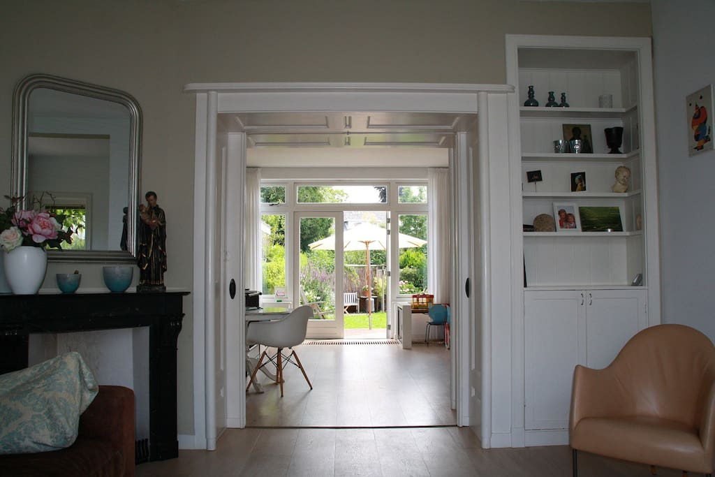 The 2 living rooms are separated by  traditional en-suite doors with stained glass (not seen in this picture)