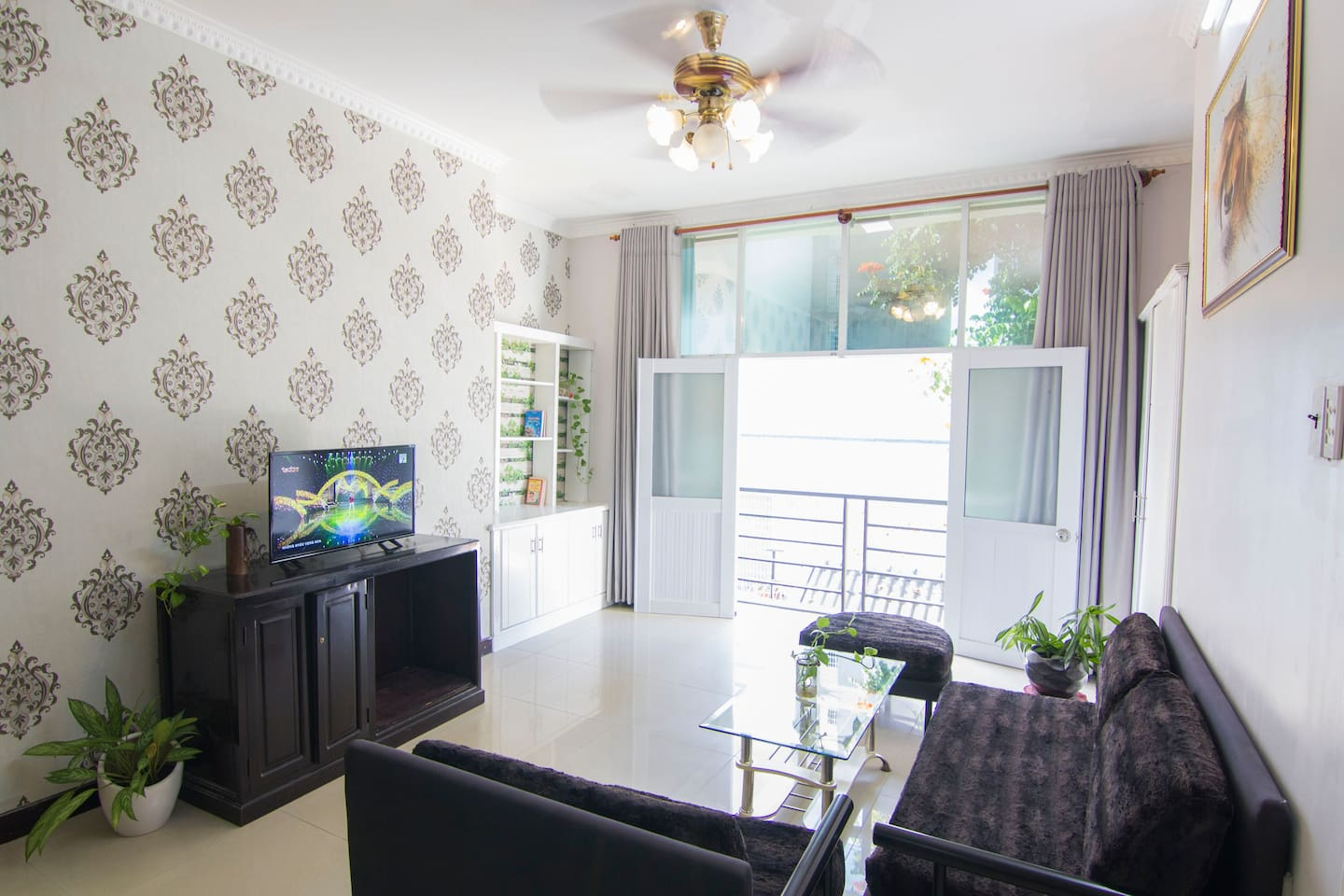 Vung Tau Villa Ali 5B has a spacious living room in the first floor with TV, sofa, bookshelf