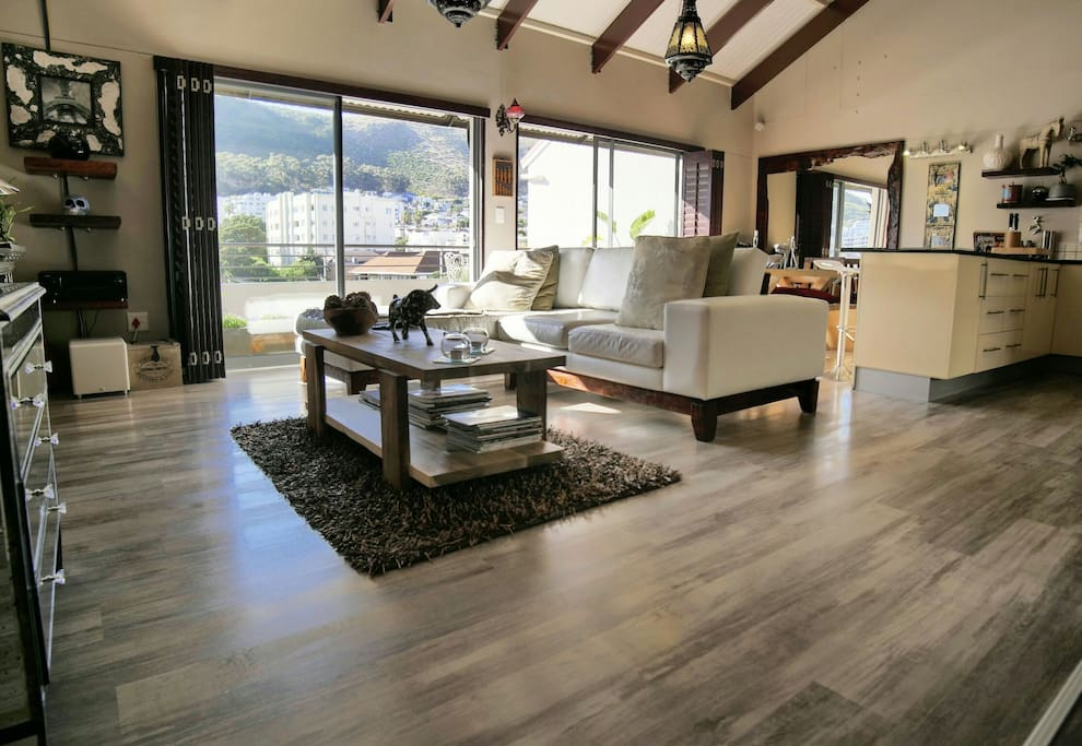 Large open plan lounge, dining and kitchen area with a full view of the mountain range.