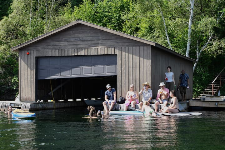 Our boat house has several paddleboards, a canoe, kayaks, and a pedal board for you to use!