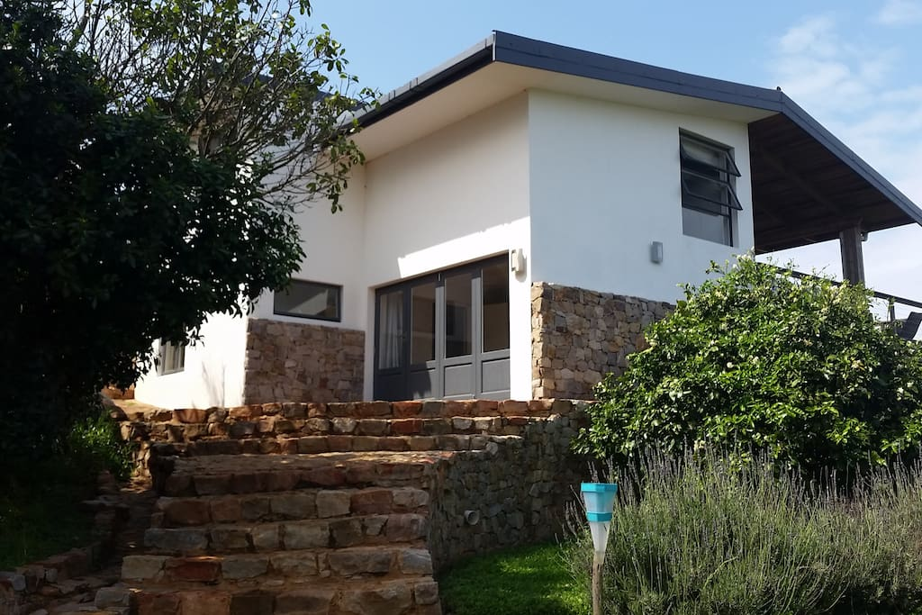 Front of the house - showing bedroom leading onto a patio