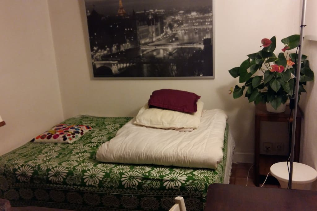 bed furnished with blankets and pillows