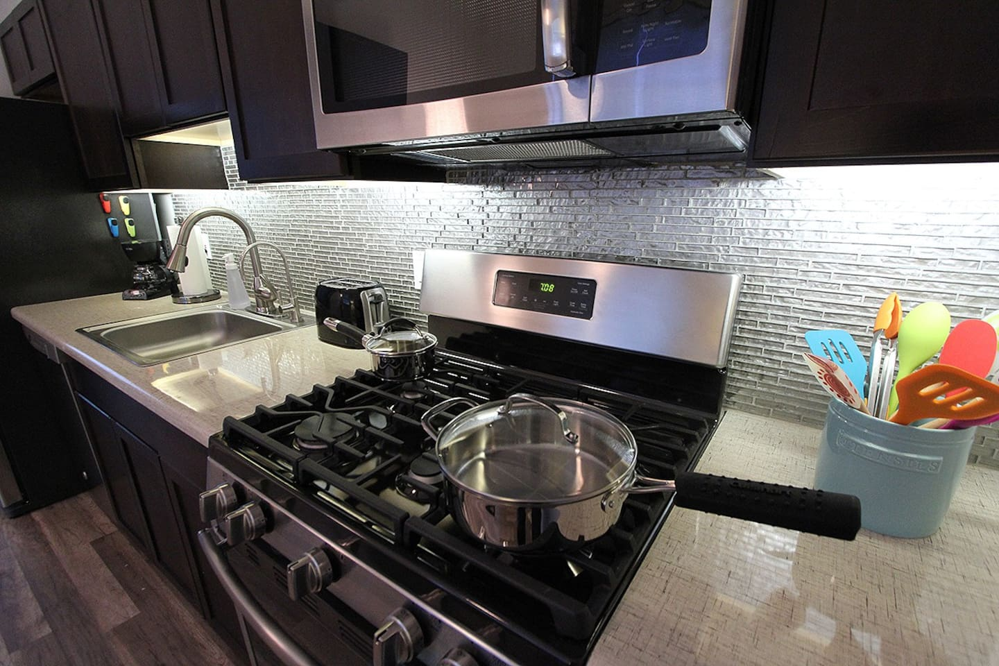 Full Kitchen with Gas Stove and Stainless Steel Appliances