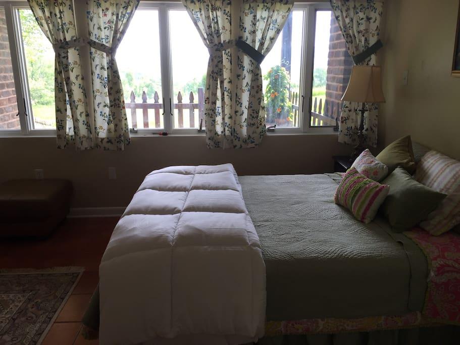 Light-filled bed room, new mattress, comfortable linens