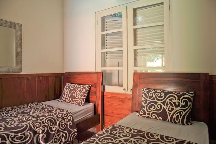 The additional bedroom has 2 full sized single beds and is ideal for 2 children