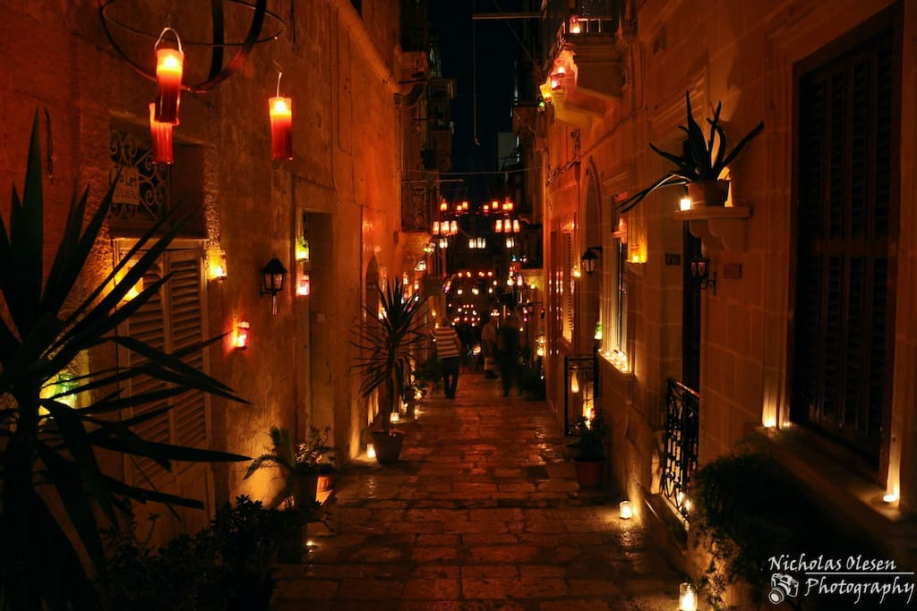 Birgufest, which is happening this coming weekend. Electricity will be switched off and Birgu will be lighten up by hundreds of candles. Traditional food, music and other entertainment.