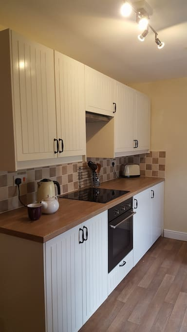 The newly fitted kitchen is well-equipped - there's a ceramic hob, oven, fridge with freezer compartment and dishwasher