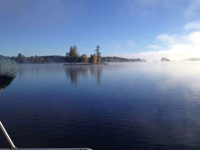 The morning October mist. The lake is starting to cool off.