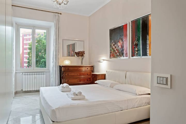 The Bedroom - The comfortable double bed with soft bed linen and towels