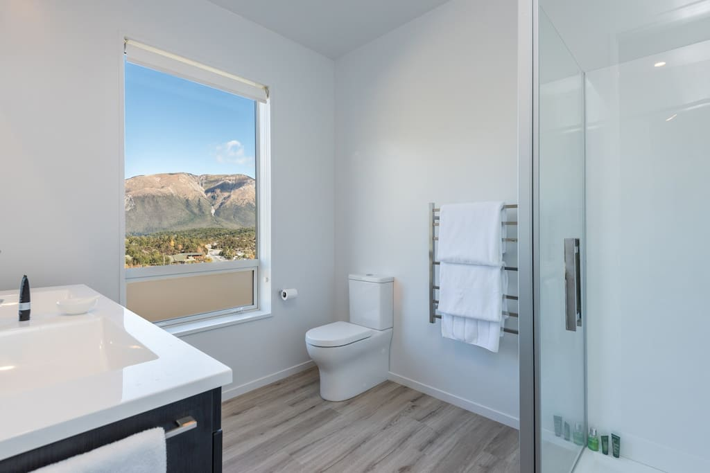 Both bathrooms have large showers and double basins (and views)