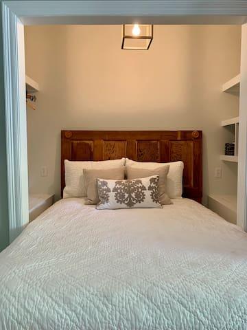 Queen Cozy bed tucked away