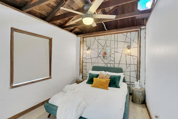 Romantic bedroom with brand new queen size mattress. Complete with ceiling fan.