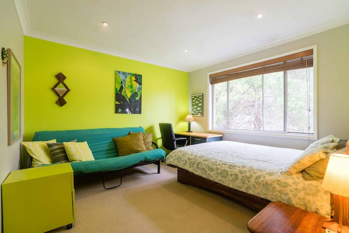 Jungle Room with queen bed & pull out futon bed (futon has been updated since this photo)