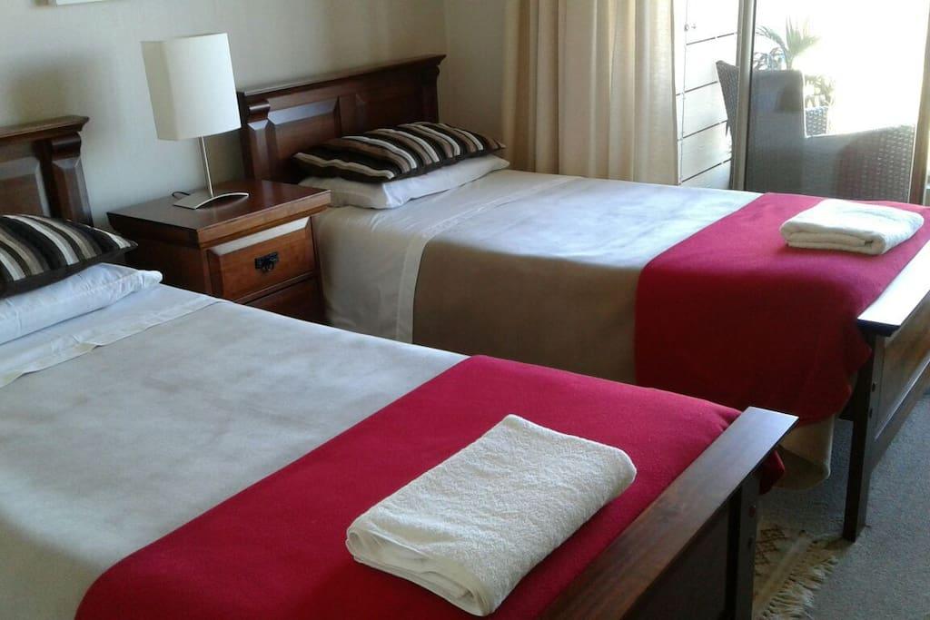 Habitación con dos camas single