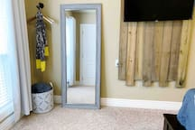 A full length mirror and hanging storage makes getting ready a snap!