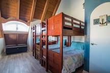 Spacious loft with 2 bunk beds (sleeps 4) and half bathroom