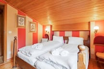 The 1° Bedroom with double bed joined together with soft bed linen and towels