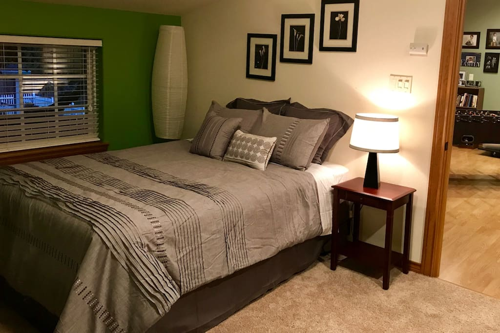Large bedroom with brand new queen bed, closet space, and desk. Guests may also access loft with foosball table and balcony.