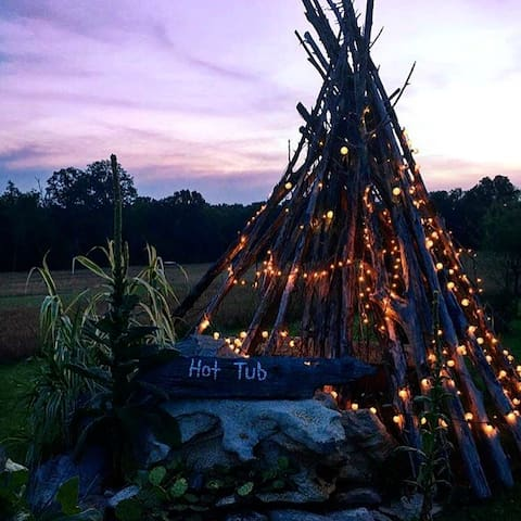 teepee in the backyard beside the fire pit