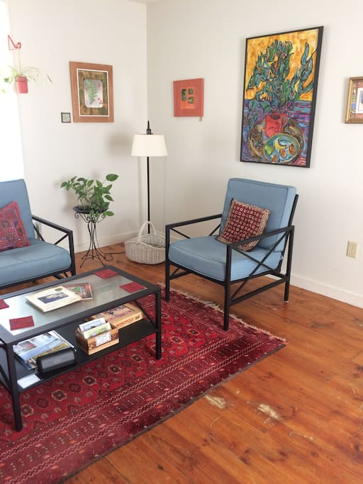 Cheery living room with homeowners art.