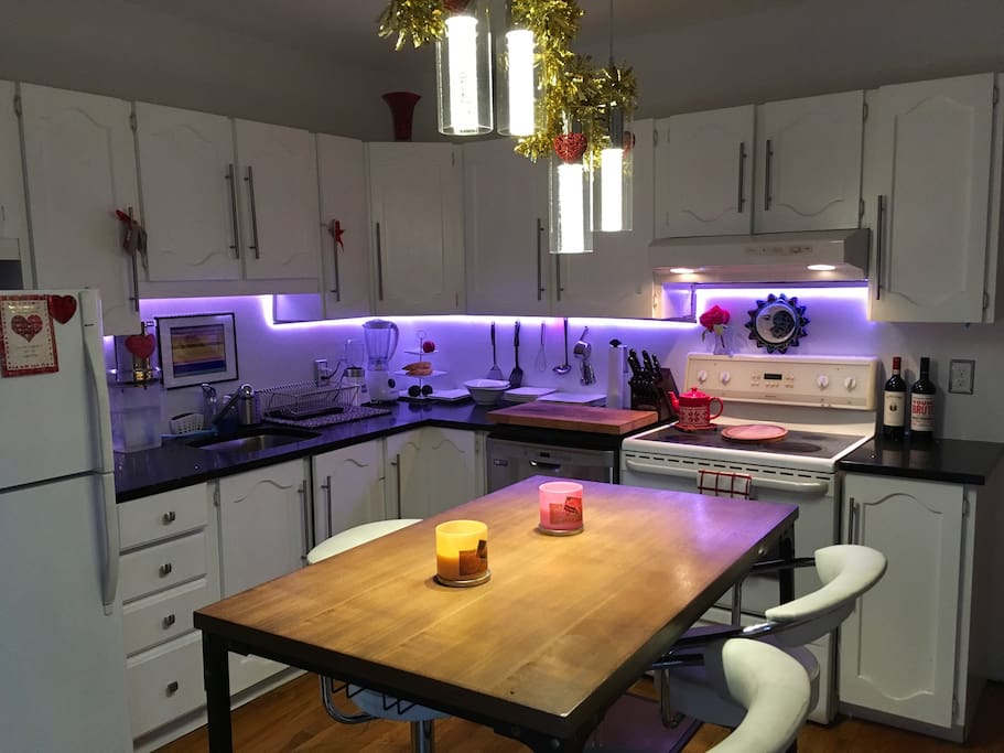 This is our renovated kitchen with black quarts countertop. Kitchen also has sliding doors that look onto a deck with outdoor lounging area. Kitchen island has total of 5 stools.
