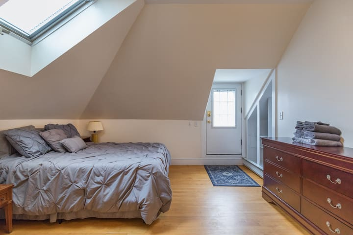 Huge, comfortable bedroom with direct access to deck