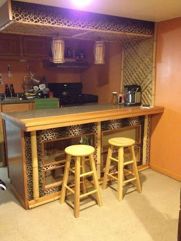 Breakfast bar includes coffee maker with a supply of coffee and tea.
