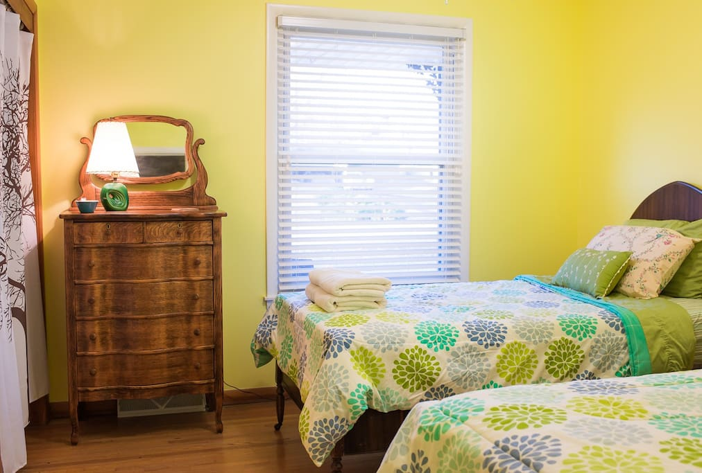 Bright room with large closet, hangers & hooks. Two comfy twin beds.