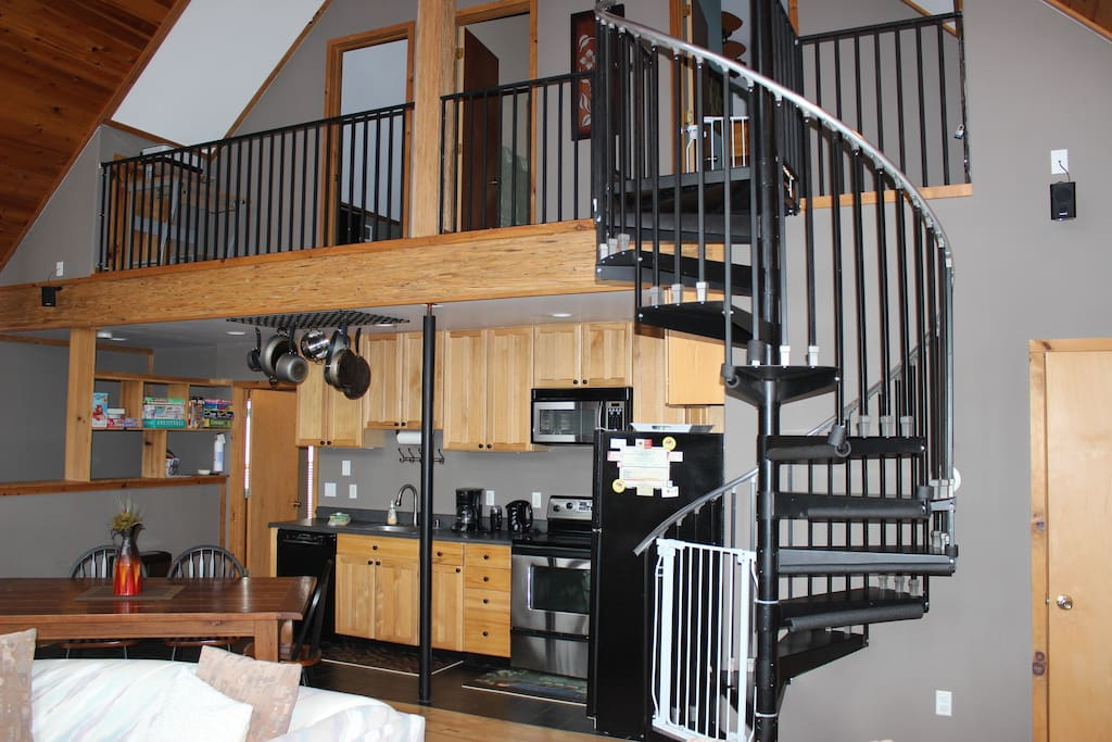 Circular Staircase to upstairs and kitchen underneath
