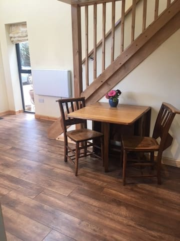 Dining Area with stairs to sleeping loft