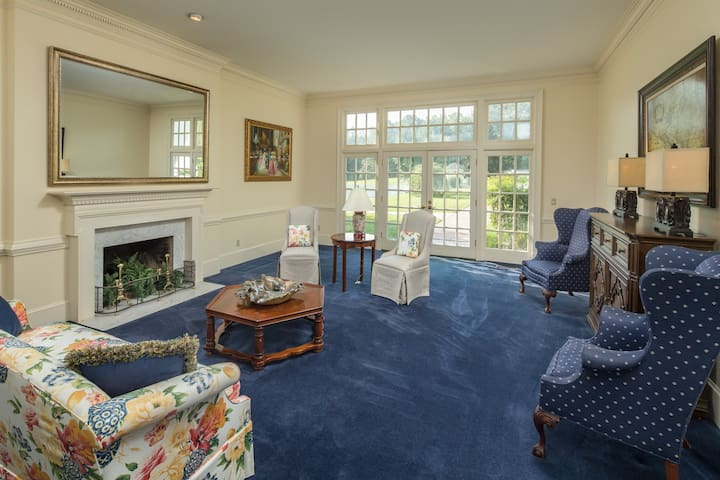 Formal living area with french doors to the gardens and pool