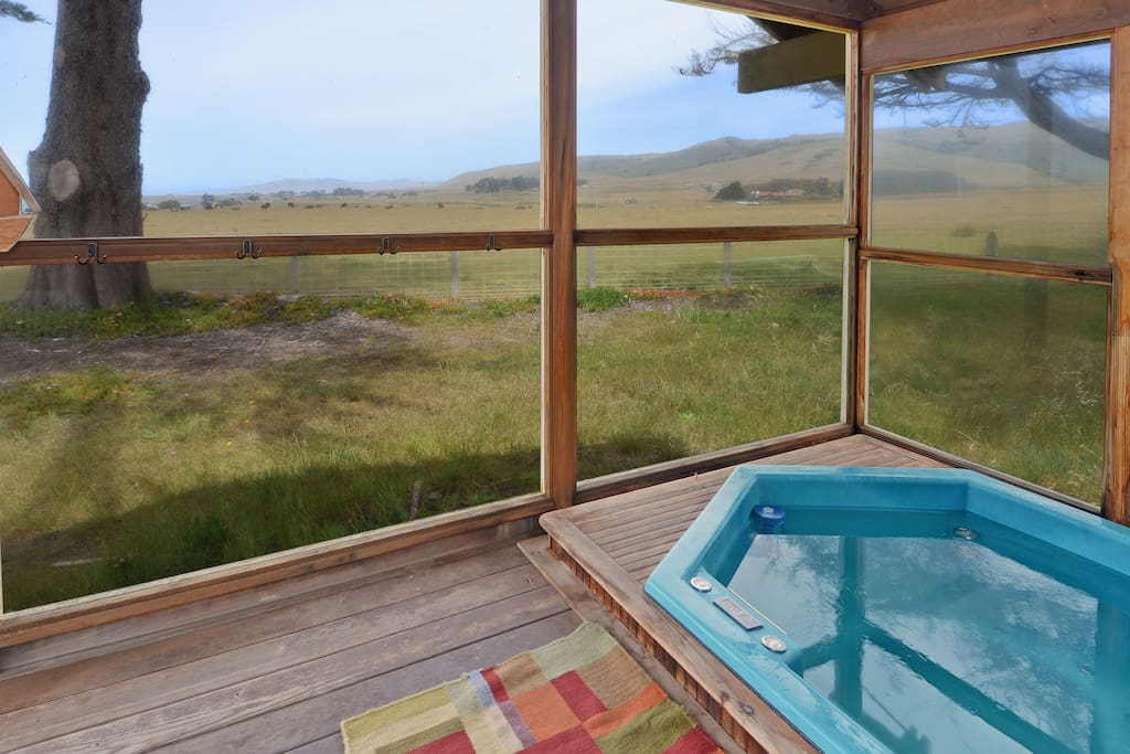 Enclosed hot tub with views of the ocean