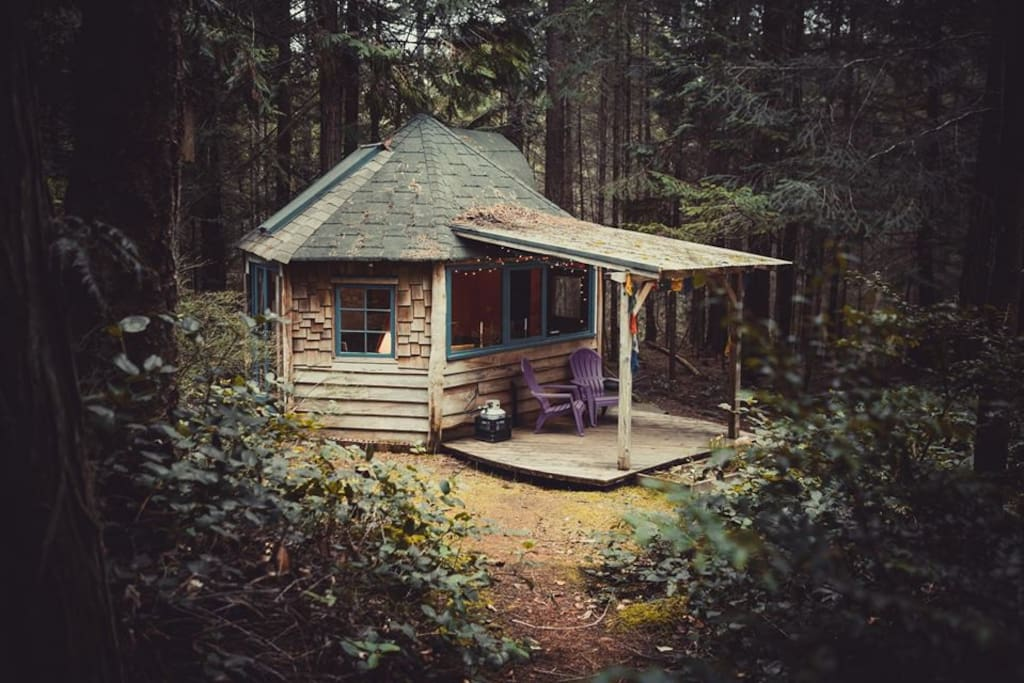 The cabin is tucked away in the woods.