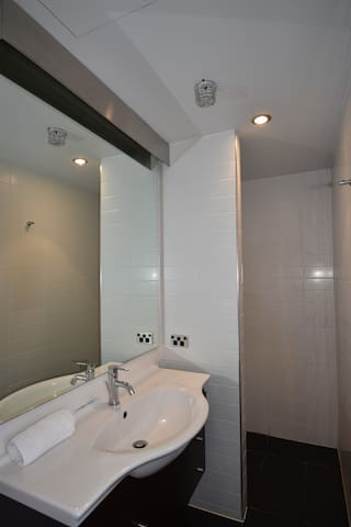 Modern en-suite bathroom with walk-in shower - please note the bathroom is narrow