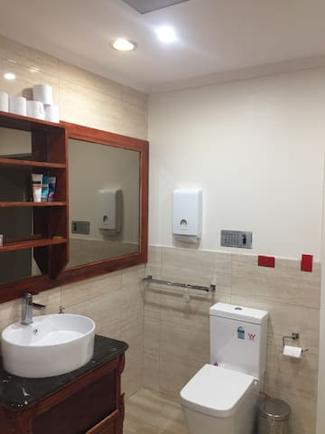 Spacious bathroom with new vanity, new basin, new tap, new toilet suite, hot/cold water for bathing.