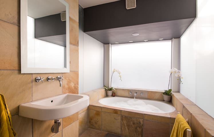 The romantic bathroom features the bath and shower of your dreams. With soft lightning, turn your bath-time into a very special occasion.