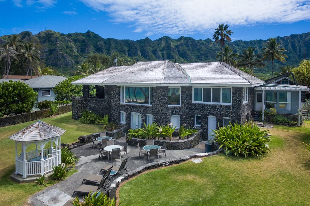 Listed on the Register of Hawaii's Historic Homes this classic restored beach house was built of lava rock during the reign of King Kalakaua.