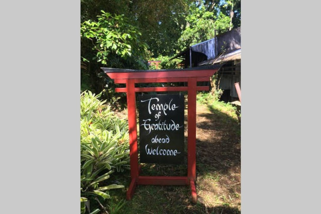 The Temple of Gratitude sign, directing guests to experience the serenity and beauty.