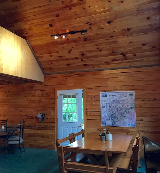 Sleeping loft opens up to dining area.