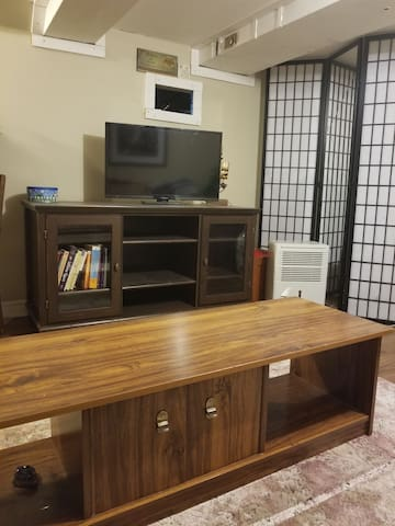 Your home away from home. Enjoy some TV and relax in private. The ceiling is a bit low in some areas.