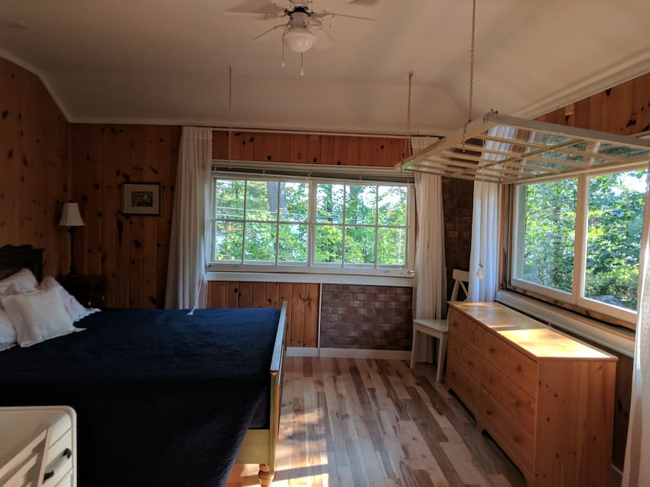 Large bedroom with king bed and lake views