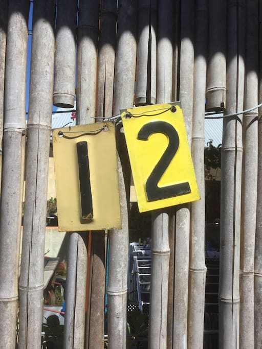Number near entrance gate to apartment and courtyard