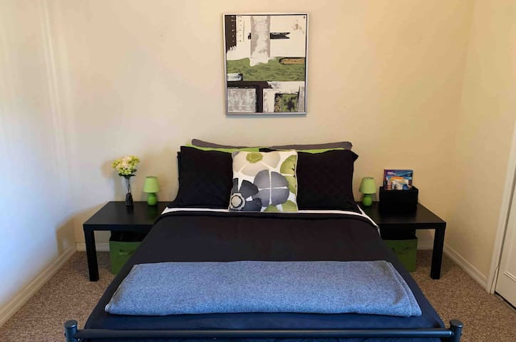 Two side tables  are conveniently provided for bedside necessities, as well as a wall outlet behind each table for charging devices within arms reach.