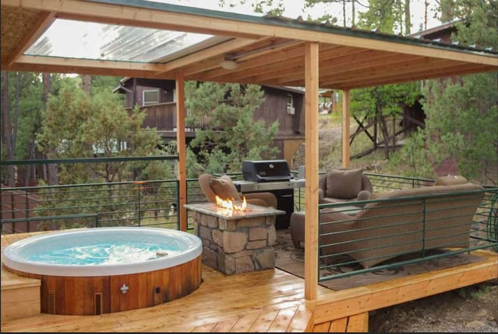 patio with fire table, hot tub, grill and outdoor furniture