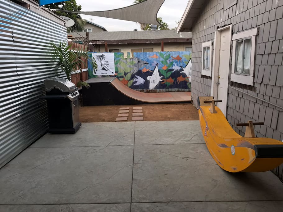 Rest of private patio with grill and skate ramp